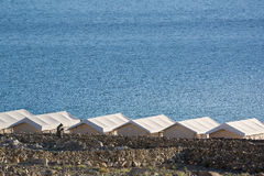 Tented tourist camp at Pangong Lake.Light and shade from sunrise Royalty Free Stock Photography