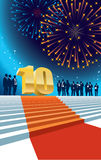 Tenth anniversary. Colorful crowd of businesspeople celebrating tenth anniversary, fireworks in the background Royalty Free Stock Photos