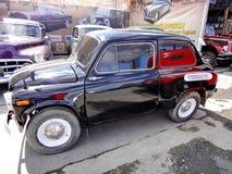 Tentoonstelling van retro auto's Zaporozhets zaz-965 vanaf 1960 tot 1969 wordt geproduceerd die Merk van Sovjet en Oekra?ense ach royalty-vrije stock foto's