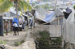 The Tents. PORT-AU-PRINCE - AUGUST 28: Children and the adults passing their time by playing cards or outdoor games in on of the Tent City on August 28, 2010 in Royalty Free Stock Photo