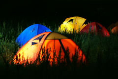 Tents. Evening lit tent in camping by nature Royalty Free Stock Photography