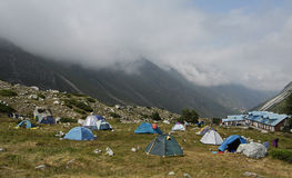 Tents on the alpine base. Group of tents located high in the Caucasian mountains in the alpine camp royalty free stock images