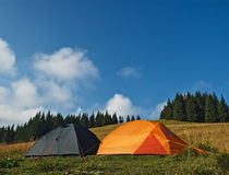 Tents at alpine meadow Royalty Free Stock Images