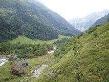 Tents on alpine mountain urbachttal on a river between mountains Stock Photography