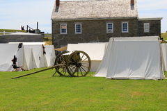 Tents and artillery set up in front of stone buildings during reenactments, Fort Ontario, New York, 2016 Stock Photos
