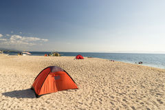 Tents on beach of white sandunder blue sky Royalty Free Stock Photography