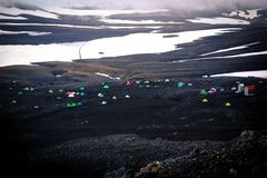 Tents built in a resting place, Landmannalaugar, Iceland. Black earth, colors, ice, snow royalty free stock image