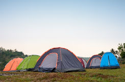 Tents at camping site dring evening time Stock Photos