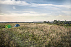 Tents on camping site in field during hunting season stock photos