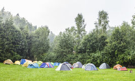 Tents in camping site in the rain. Stock Photo