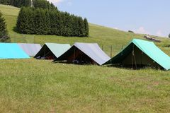 Tents of a campsite of the boy scouts in the mountains Royalty Free Stock Photography