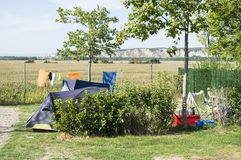 Tents on campsite. Green meadow royalty free stock photos