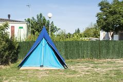 Tents on campsite. Green meadow royalty free stock photography