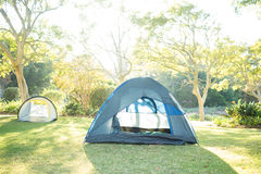 Tents at campsite on a sunny day. Two tents at campsite on a sunny day royalty free stock image
