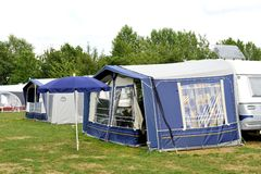 Tents and a caravan royalty free stock photography