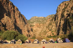 Tents in a desert canyon Stock Photo