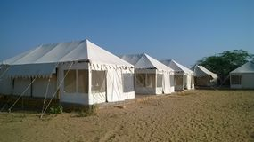 Tents in desert. White tents built in desert for stay arrangement of guests in Jaisalmer, Rajasthan, India Royalty Free Stock Photography