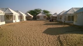 Tents in desert. White tents built in desert for stay arrangement of guests in Jaisalmer, Rajasthan, India Royalty Free Stock Image