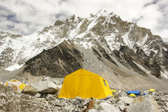 Tents in Everest Base Camp, Nepal. Tents in Everest Base Camp in cloudy day. Here starts the climb to reach the top of the highest mountain in the world Stock Image