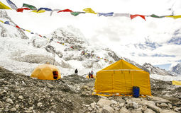 Tents in Everest Base Camp, Nepal. Tents in Everest Base Camp in cloudy day. Here starts the climb to reach the top of the highest mountain in the world Stock Photo