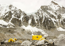 Tents in Everest Base Camp, Nepal. Tents in Everest Base Camp in cloudy day. Here starts the climb to reach the top of the highest mountain in the world Stock Images