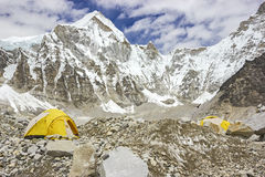 Tents in Everest Base Camp, Nepal. Tents in Everest Base Camp in cloudy day. Here starts the climb to reach the top of the highest mountain in the world Royalty Free Stock Images