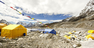Tents in Everest Base Camp, Nepal. Tents in Everest Base Camp in cloudy day. Here starts the climb to reach the top of the highest mountain in the world Royalty Free Stock Photos