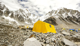 Tents in Everest Base Camp, Nepal. Tents in Everest Base Camp in cloudy day. Here starts the climb to reach the top of the highest mountain in the world Stock Photos