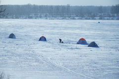 Tents fishermen on ice of the lake. Tents of fishermen on the ice of the lake Royalty Free Stock Photography