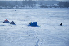 Tents fishermen on ice of the lake. Tents of fishermen on the ice of the lake Royalty Free Stock Photo
