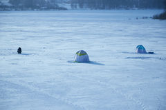 Tents fishermen on ice of the lake. Tents of fishermen on the ice of the lake Royalty Free Stock Photos