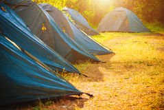 Tents in a forest. Selective focus. Royalty Free Stock Images