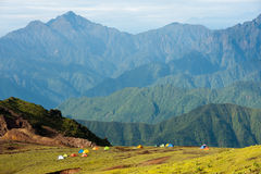 Tents in front of mountains. Several tents are settled in front of mountains by backpackers Royalty Free Stock Image