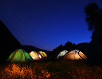 Tents glow at night   in the forest Stock Photo