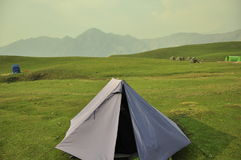 Tent in a hilly area Royalty Free Stock Images