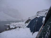 Tents at the lake shore in the snowy morning Stock Photography