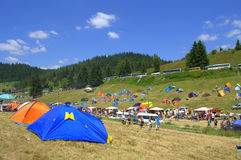 Tents at mountain fairground Stock Photography