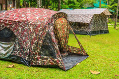Tents in National Park. Tents with Soldier Pattern in National Park Royalty Free Stock Photos