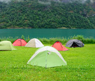 Tents near fjord in Norway Royalty Free Stock Image