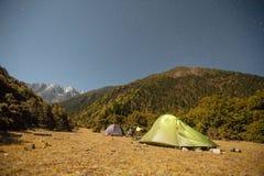Tents at night in the Himalayas, China stock photo
