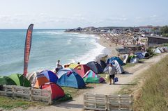 Tents pitched along the road. Free camping beach area in Vama Veche in Romania, on the Black Sea coast stock photo