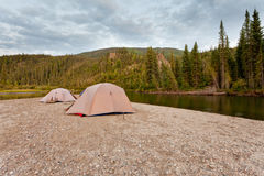 Tents at river in remote Yukon taiga wilderness Stock Photo