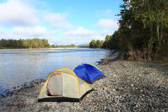 Tents at the river Royalty Free Stock Photos