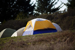 Tents Set Up At Camp Site Sloping Hill Stock Photos