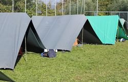 Tents set up in a campground in Meadow Green Royalty Free Stock Image