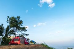Tents sleep  above the hills, and the atmosphere in the morning. Stock Photo