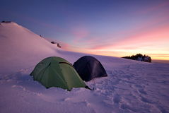 Winter mountain landscape. Tent in sunset light. Tents in the snow - Piatra Mare Mountains, landmark attraction in Romania. Winter mountain landscape. Tent in stock images