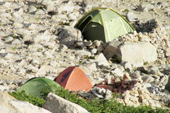 Tents standing in the wild mountains Stock Images
