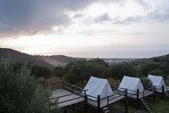 Tents at sunset. Touristic camping  in Acquedolci, Sicily at the sunset Royalty Free Stock Photo