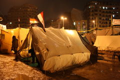 Tents In tahrir during Egyptian revolution at nigh. T, rainy ground Stock Photos